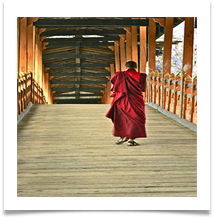 Bhutan. Monk crossing the bridge at Punakha - Richard Nicholls