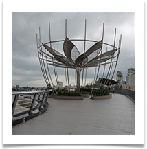 Cambodia. Phnom Penh. Lotus Footbridge on waterfront - Richard Nicholls